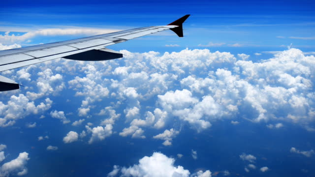 airplane flying above the cloud - aircraft wing stock videos & royalty-free footage