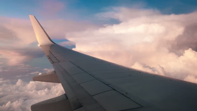 airplane flying into the storm - business travel stock videos & royalty-free footage