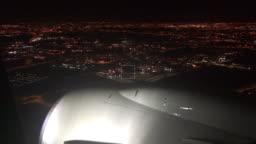 airplane  flying low pre landing at night