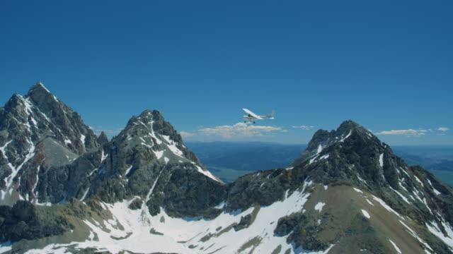 Airplane flying near the Grand Teton Mountain Range