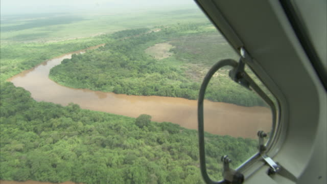 airplane flying over a river and a forest in ethiopia. available in hd - ethiopia stock videos & royalty-free footage
