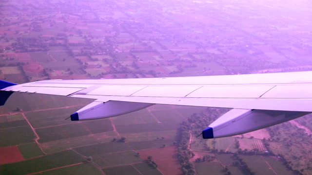 Airplane flying over agricultural land