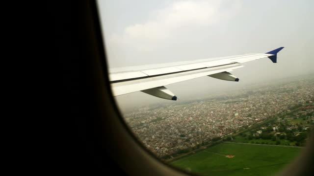 Airplane flying over Delhi city