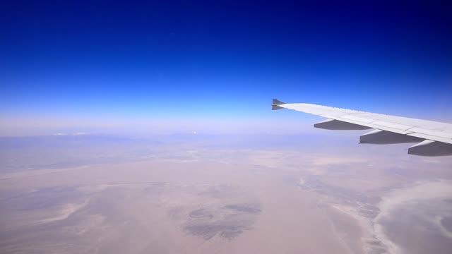 Airplane flying over desert