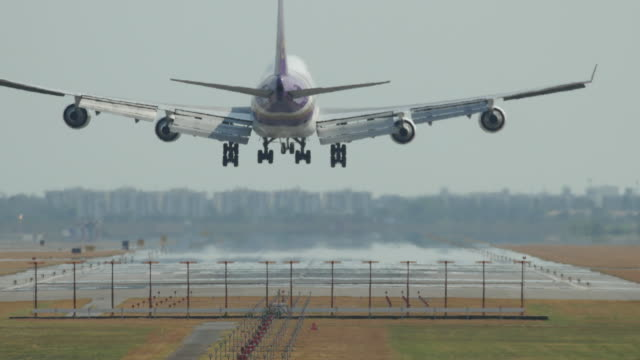 airplane flying over head near airport - runway stock videos & royalty-free footage