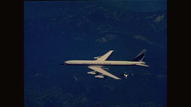 WS TS DC-8 airplane flying over mountains / United States