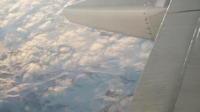 Airplane flying over snowcapped mountain