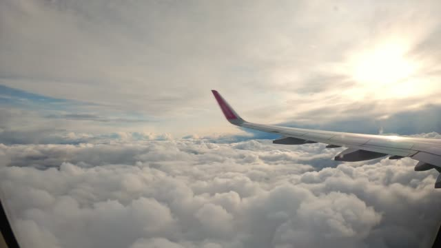 airplane flying over the clouds - cumulonimbus stock videos & royalty-free footage