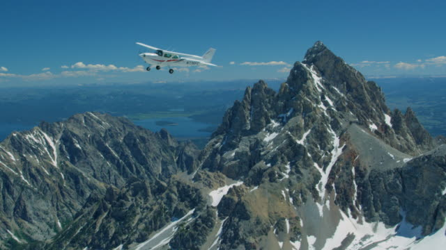 airplane flying over the grand teton - grand teton stock videos & royalty-free footage