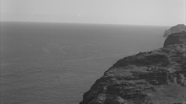 ws arial airplane flying over water and lands near lihue airport at  lihue hawaii - 1959 bildbanksvideor och videomaterial från bakom kulisserna