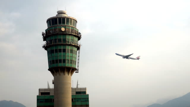 Airplane flying pass Air Traffic Control Tower