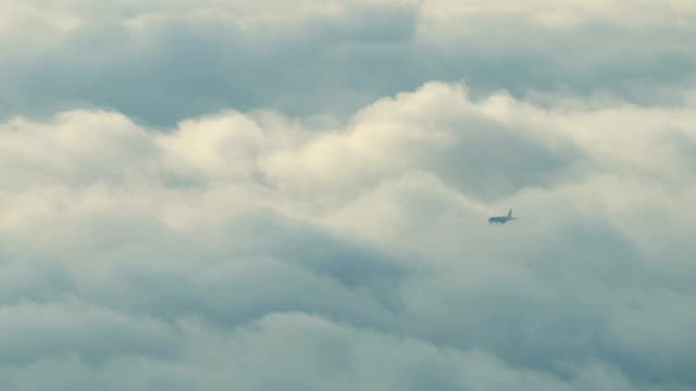 airplane flying through fog. - arrival stock videos & royalty-free footage
