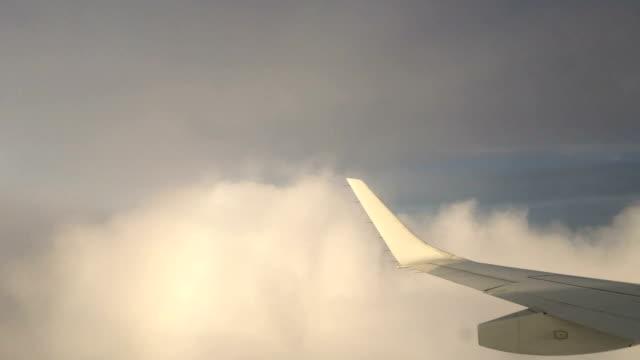 Airplane Flying Thru Clouds