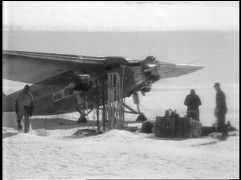 airplane for byrd's flight over the south pole taxiing slowly past crew / documentary - 1920 1929 stock videos & royalty-free footage