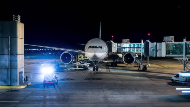 airplane landed with workers in the airport of buenos aires timelapse at night - passenger stock videos & royalty-free footage
