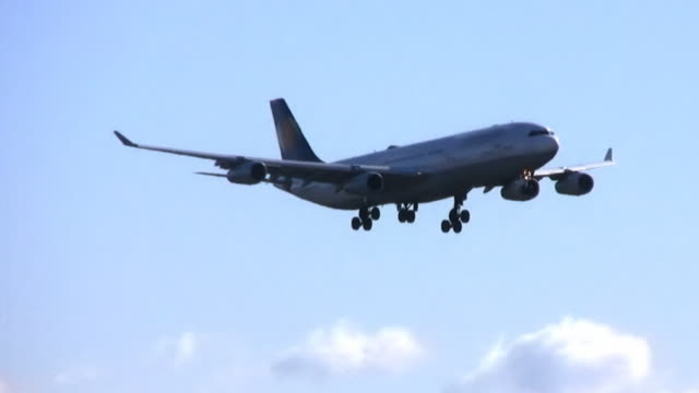 Airplane landing, airport, approaching runway (HD)