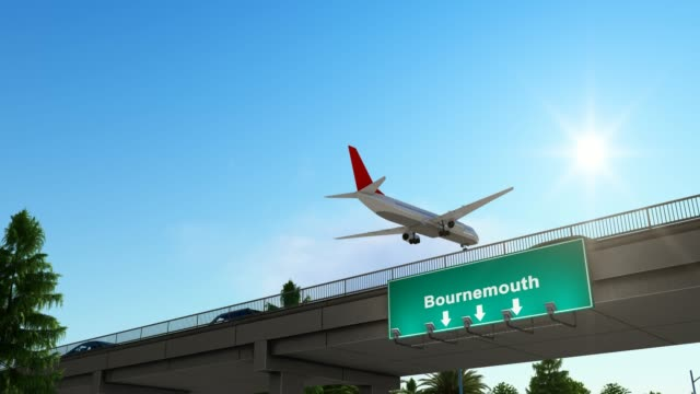 airplane landing at bournemouth airport england - pinaceae stock videos & royalty-free footage