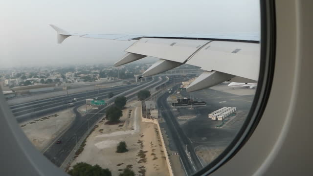 airplane landing at dubai airport - landing touching down stock videos & royalty-free footage