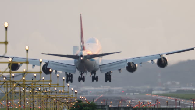 airplane landing at dusk - aerospace stock videos & royalty-free footage