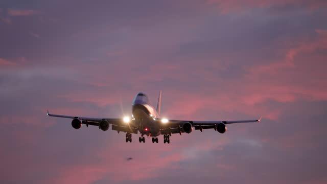 airplane landing at dusk - sunset stock videos & royalty-free footage