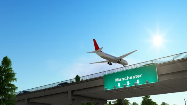 airplane landing at manchester airport england - pinaceae stock videos & royalty-free footage