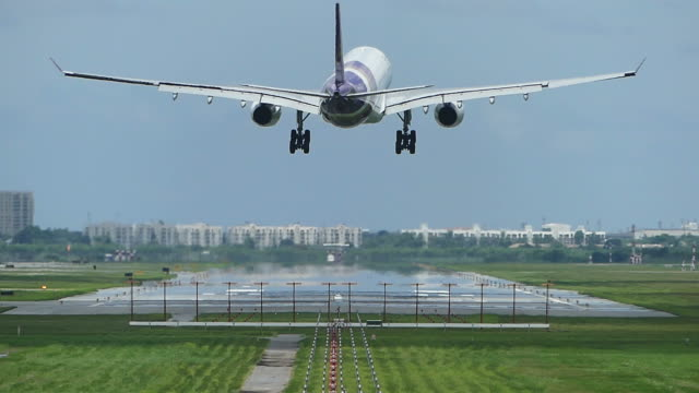 airplane landing at the airport - runway stock videos and b-roll footage