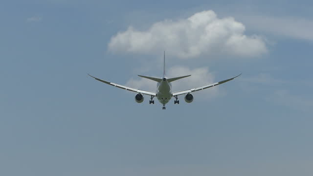 airplane landing at the airport - airplane hangar stock videos and b-roll footage