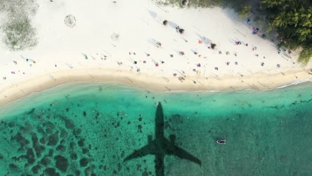 airplane landing in a tropical island - holidays start - overhead view stock videos & royalty-free footage