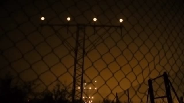 airplane landing in the barcelona airport at night from viewpoint. - atmosphere filter stock videos and b-roll footage