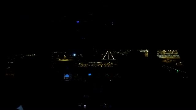 airplane landing night (cockpit view)