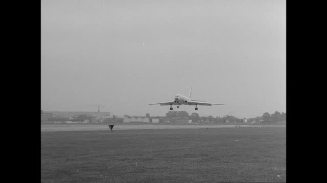 MONTAGE Airplane landing on airport runway / United Kingdom