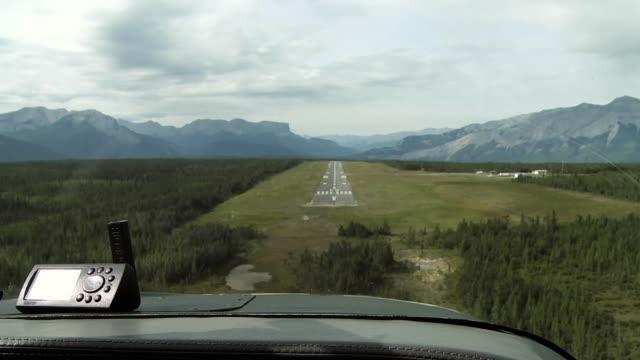 POV Airplane landing on runway in mountain landscape, Jasper National Park, Alberta, Canada