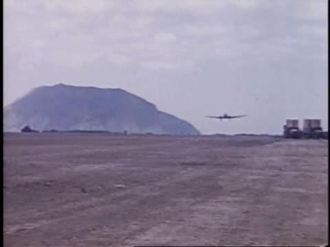 airplane landing on runway / iwo jima, japan - isola iwo jima video stock e b–roll