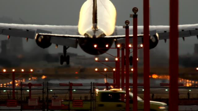 hd airplane landing on runway - transportation stock videos & royalty-free footage