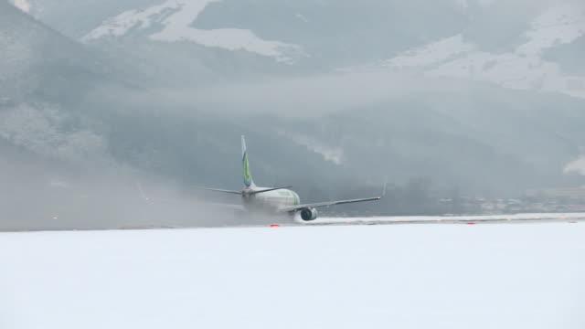 Airplane landing on the Innsbruck airport