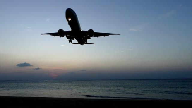 Airplane landing over Phuket sea, Thailand