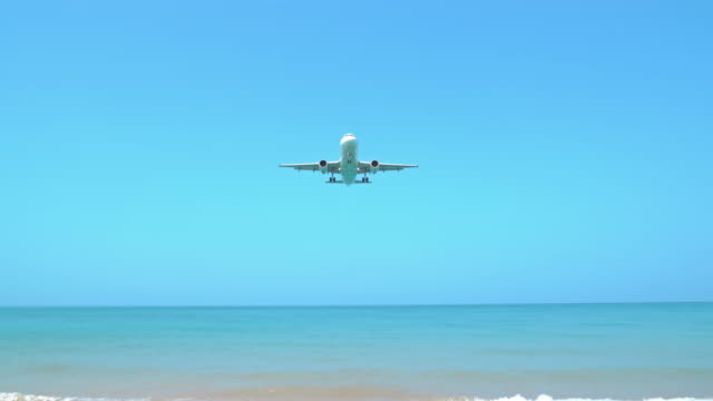 airplane landing over the sea - fighter plane stock videos & royalty-free footage