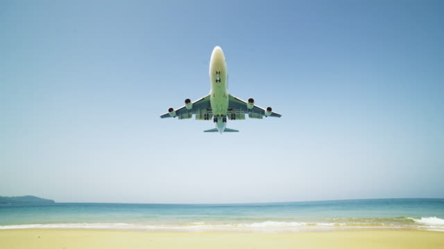 airplane landing over the sea - 4k resolution stock videos & royalty-free footage