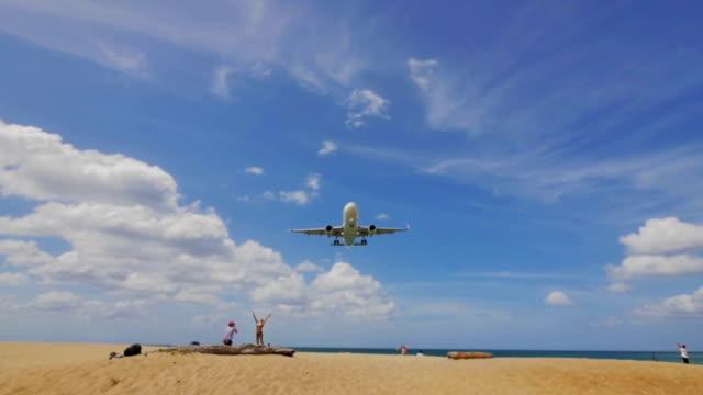 stockvideo's en b-roll-footage met vliegtuig landing op zee - militair vliegtuig