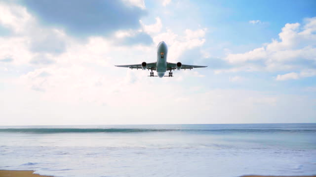 airplane landing over the sea - military aeroplane stock videos & royalty-free footage