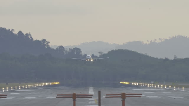 airplane landing.(4k) - landing touching down stock videos & royalty-free footage