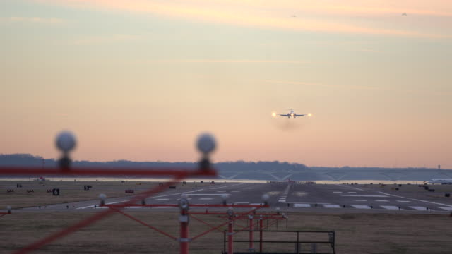 airplane lands at sunset - ronald reagan washington national airport stock videos and b-roll footage