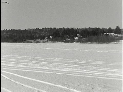 1935 ws pan airplane on skis landing on snow-covered airfield - 1935 stock videos & royalty-free footage