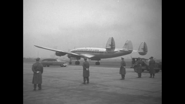 airplane on tarmac carrying presidentelect dwight d eisenhower starts engines / airplane taxis away / shot from below of eisenhower's wife mamie... - wife carrying stock videos and b-roll footage