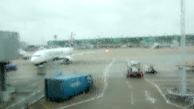 airplane parked on a rainy day - trolley stock videos and b-roll footage