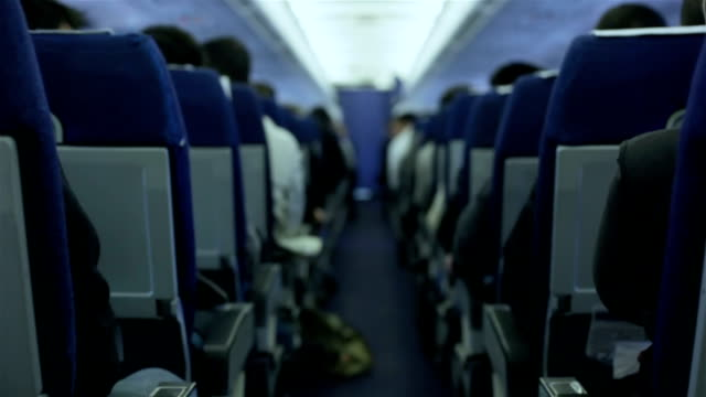 airplane passengers during a flight - inside of stock videos & royalty-free footage