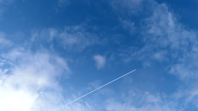 airplane passing the sky - wide stock videos & royalty-free footage