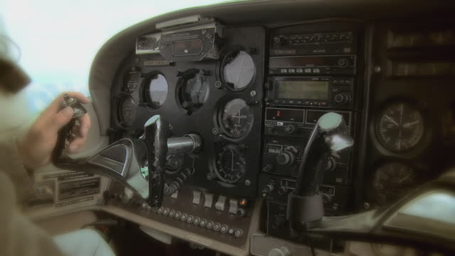 cu airplane pilot's hand on control wheel - プロペラ機点の映像素材/bロール