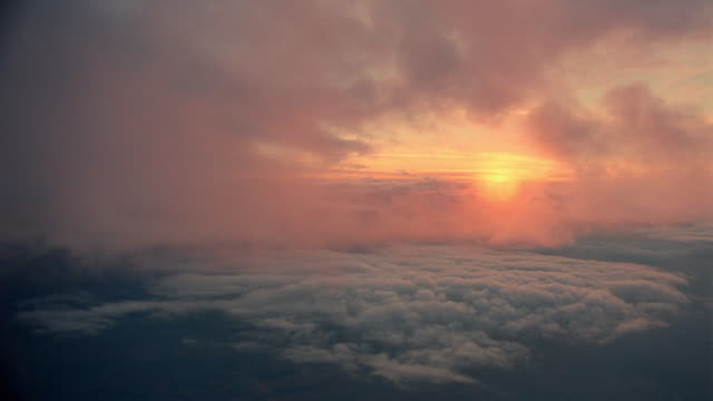 airplane point of view above white fluffy clouds at sunset / oxfordshire, england - romantische stimmung stock-videos und b-roll-filmmaterial