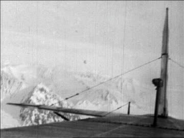 airplane point of view byrd's airplane flying over mountains near north pole / newsreel - 1926 stock videos & royalty-free footage